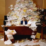 desk-with-pile-of-papers-300x300